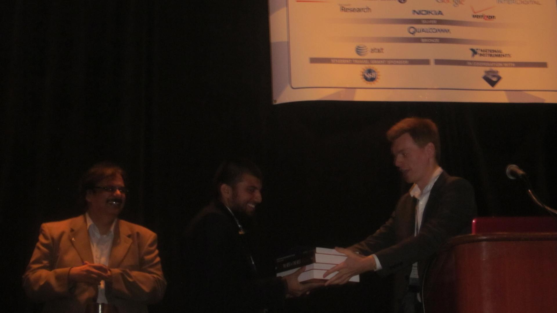 Fahd Ahmed Khan Receiving Best Poster Award At IEEE DYSPAN 2012