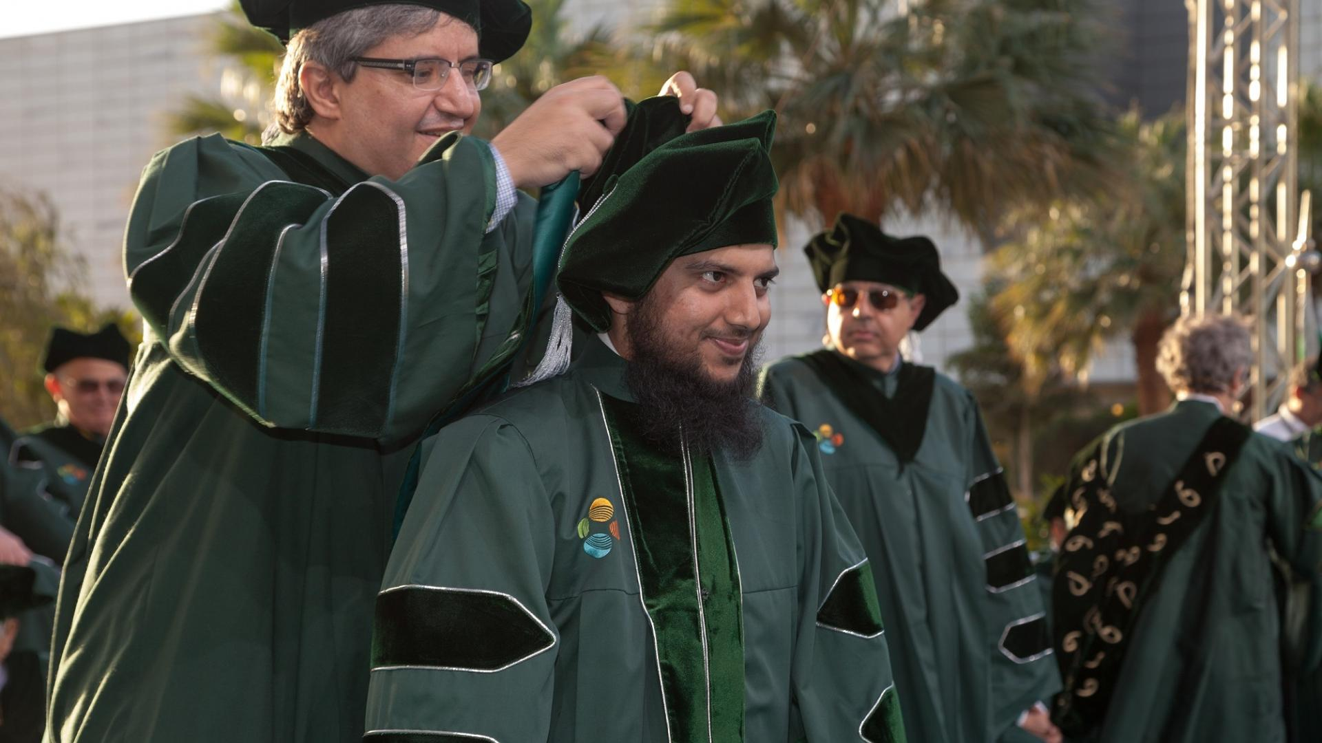 Professor Alouini awarding the Doctoral Hood to Fahd Khan during his graduation