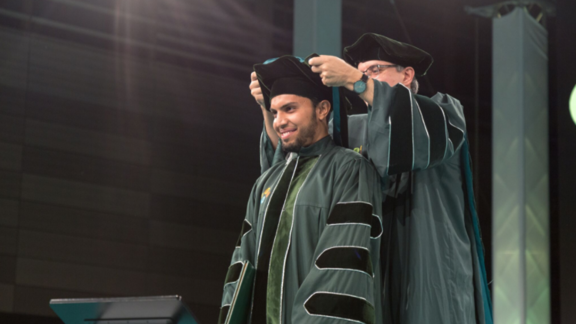 Professor Alouini awarding the Doctoral Hood to Lokman Sboui during his graduation
