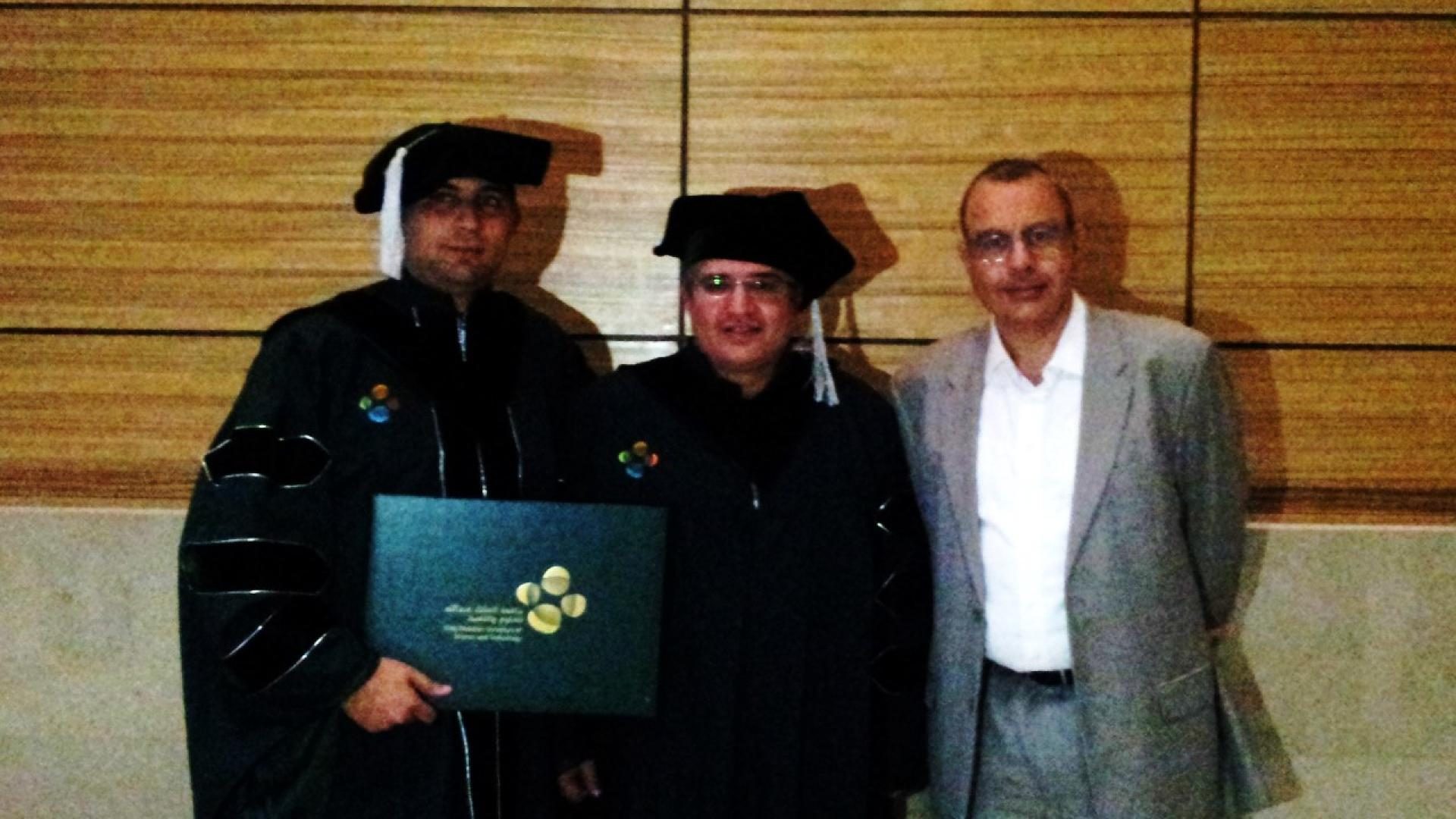 Professor Alouini with Hakim Ghazzai and Dean Mootaz Elnozahy during graduation ceremony