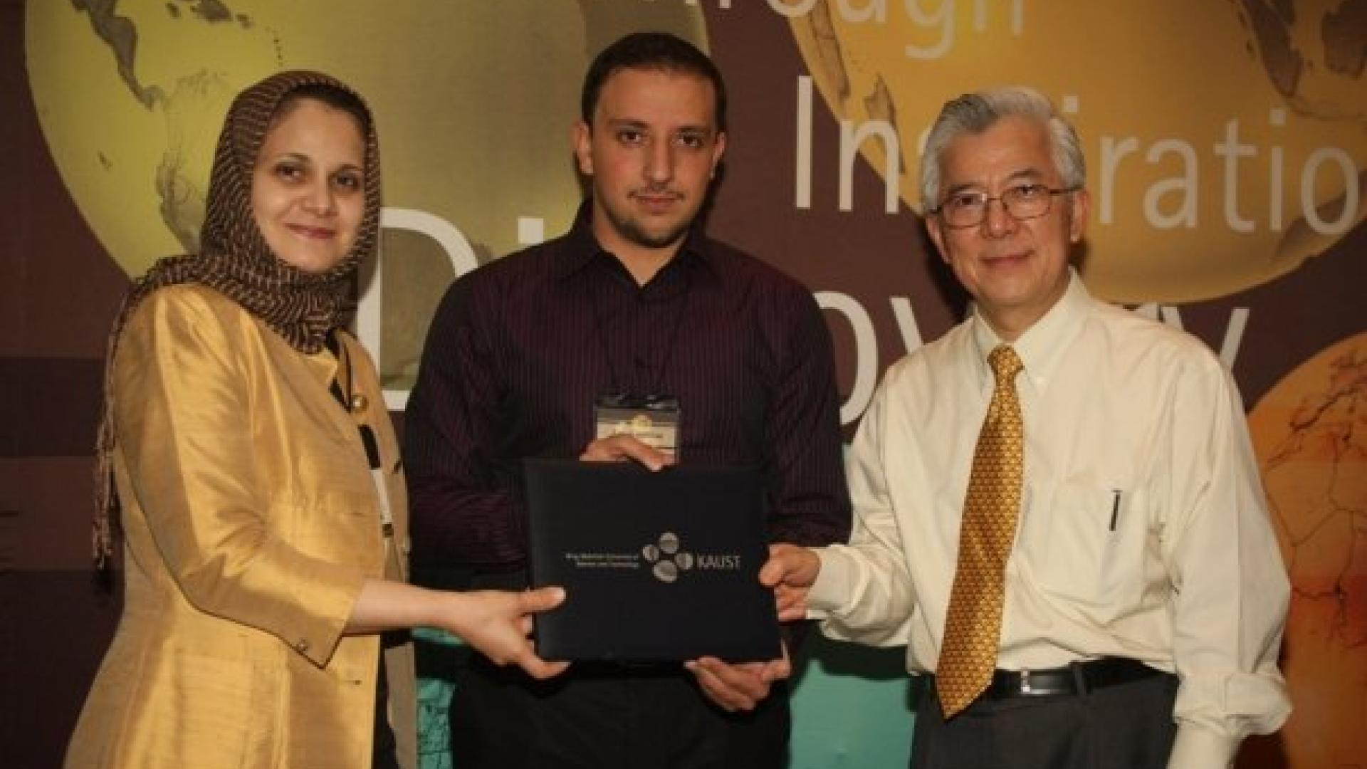 Tamim Murad Receiving Discovery Scholarship Award (Jan. 2010).